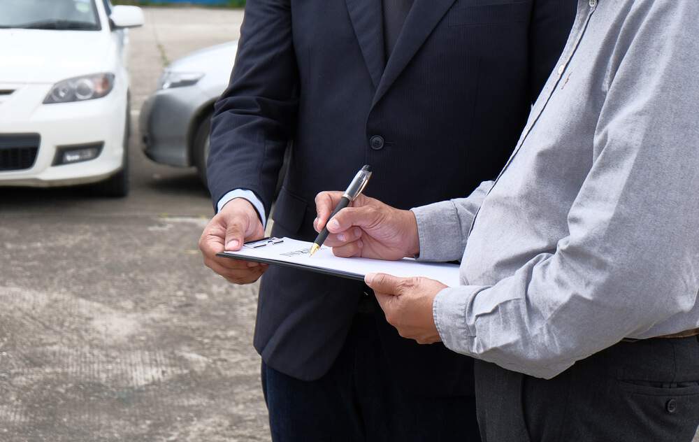 Two Men Filling Out a Form